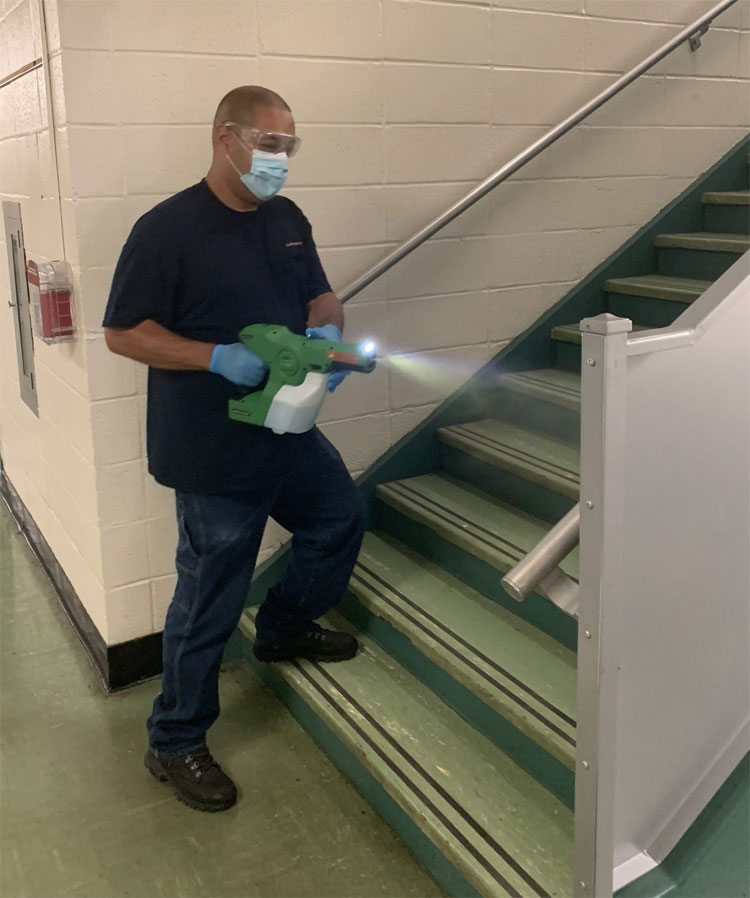 A custodial staff member working tirelessly to keep our school building safe and sanitized for our students and staff!