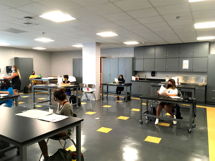 Our students learning in the newly remodeled art room.