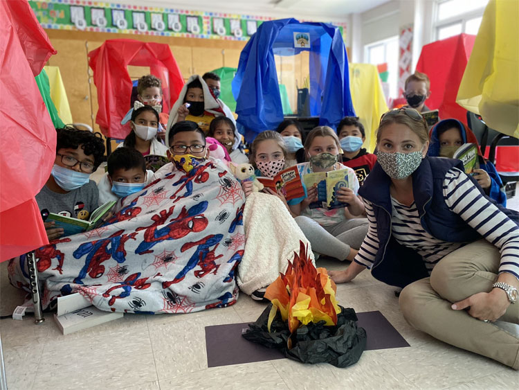 Third graders are  camping out with a good book today!