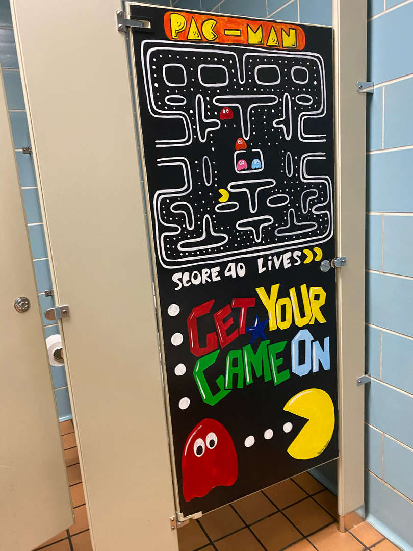High School Art Students painted murals at West Newton Elementary.