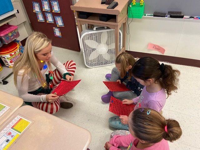Santa's Helpers Sarah with first graders @West Newton Elementary