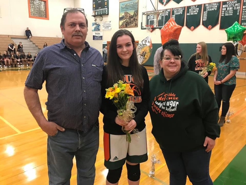 Girls Basketball Senior Night - Cara with her parents