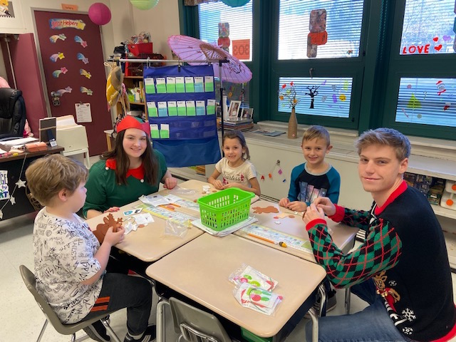 Santa's Helpers Sydney and Jacob with first graders @West Newton Elementary