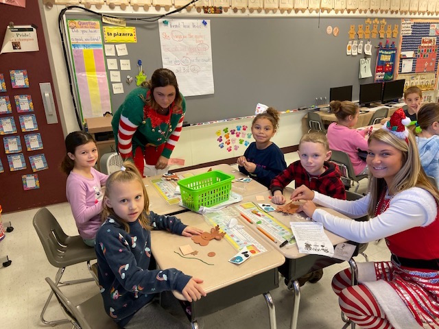 Santa's Helpers Sara and Jordyn with first graders @West Newton Elementary