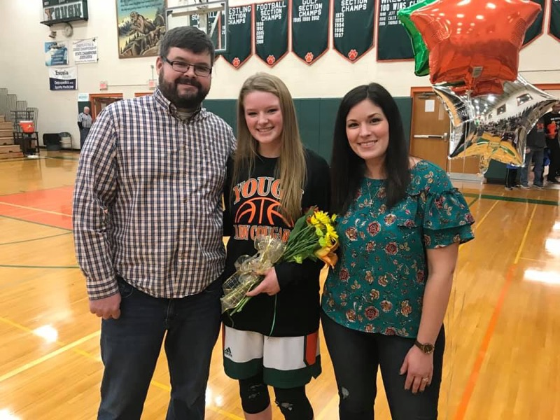 Girls Basketball Senior Night - Corrin with her parents