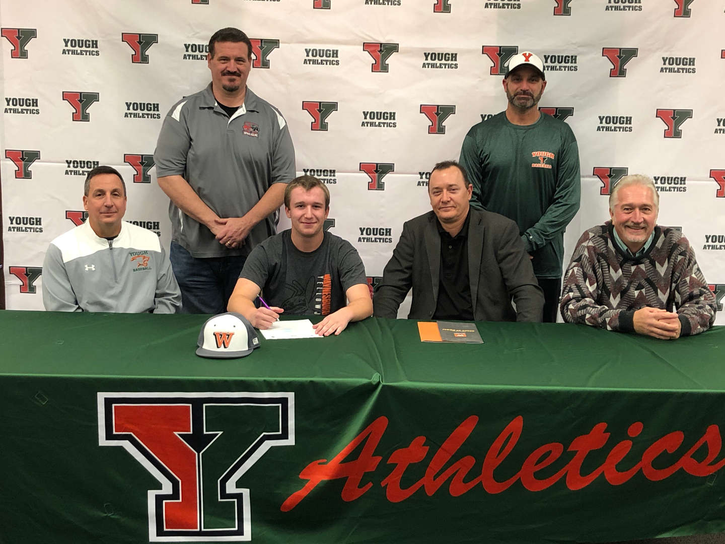Michael Bell signing to attend Waynesburg University for baseball and academics.  Michael is shown with:  Coach Spisak, Brian Dippolito, School Board Member Jared Filapose, Ken Pritts and School Board Member Al Novacek