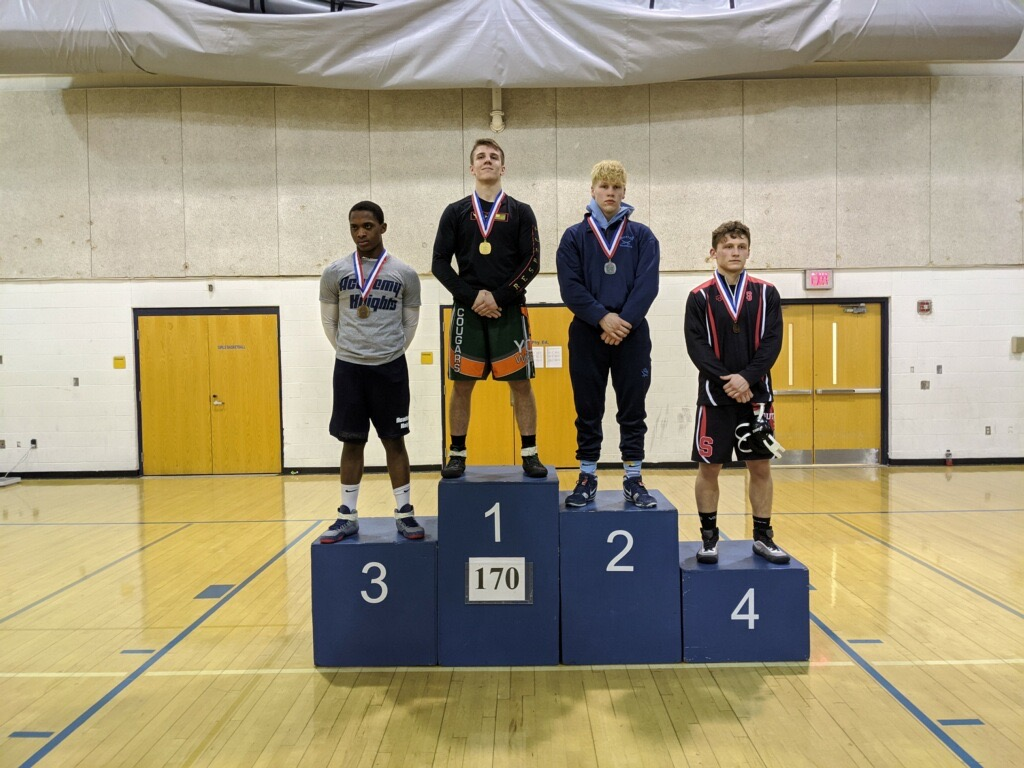 Wrestler Glenn Christner on the podium at sectionals FIRST PLACE (170 weight class)