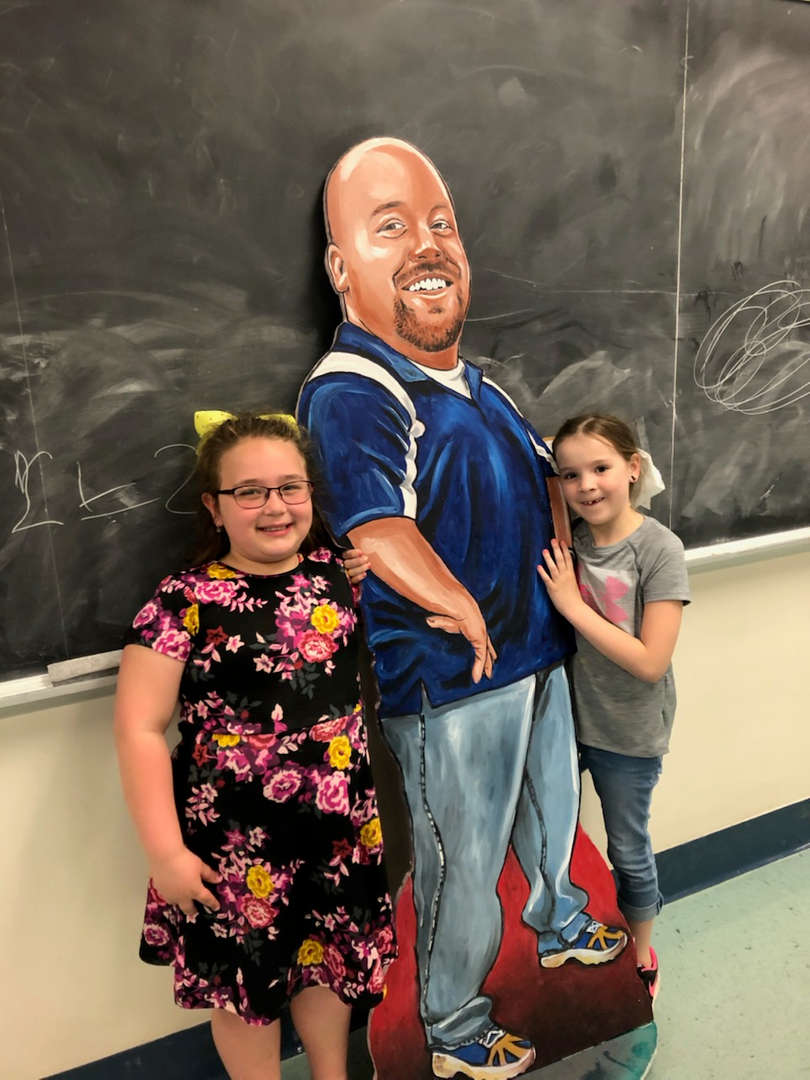 Maddy and Addison w/Mr. Betlan statue!!!! Bring your child to work day at YHS!!!!