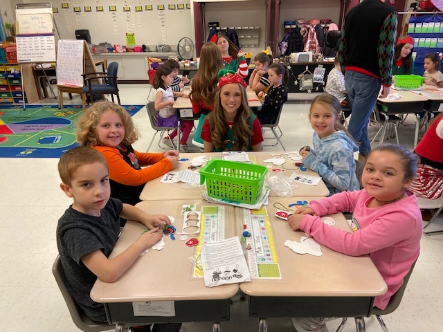 Santa's Helper Taylor with first grade students @West Newton Elementary