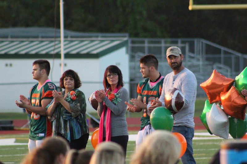 Football Senior Night 10/5/18 George with his mom and Dustin with his mom and dad.