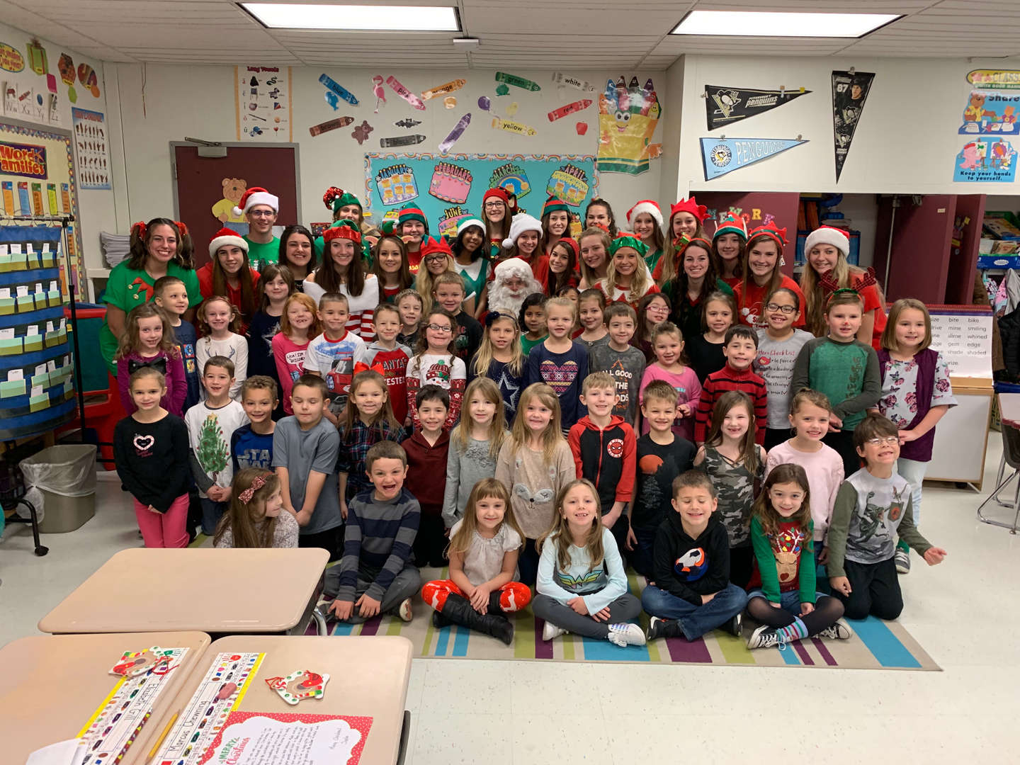 Student Council Santa aka Nick and his Elves with students from Mrs. Virgin & Miss Skrgic's 1st grade classes.