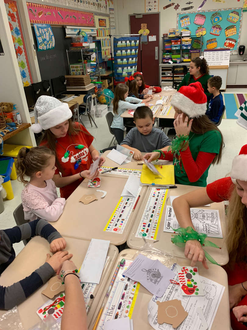 Student Council Elves with students in Miss Skrgic and Mrs. Virgin's 1st grade classes.