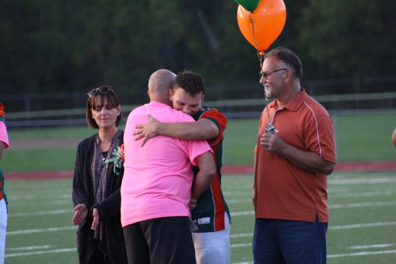 Football Senior Night 10/5/18 Cameron with Coach Wood and his parents