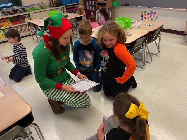 Santa's helper Julia with first graders @West Newton Elementary