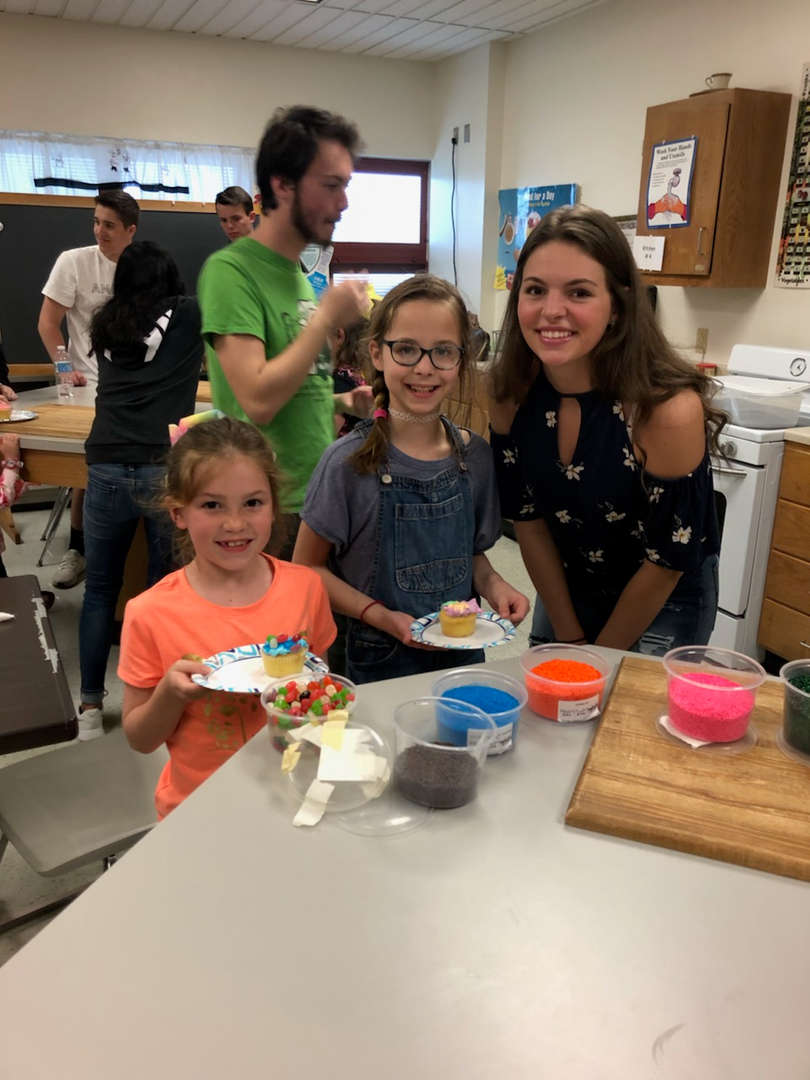 Mckenzie and Maeve w/ Gina! Bring your child to work day! Making cupcakes.