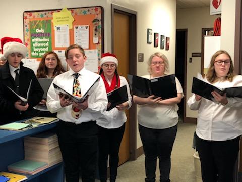 Chamber Choir spreading Christmas joy in the high school office!