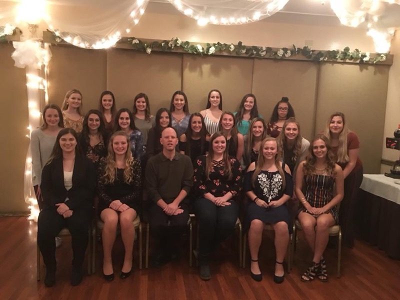 Coach German with the Volleyball Team at their end of the season banquet.