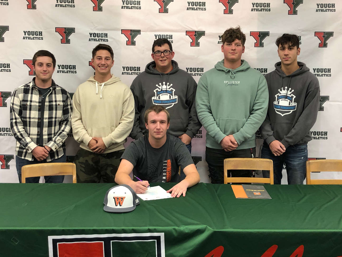 Michael Bell shown with his teammates at his signing to attend Waynesburg University.  Steve, Caden Gino, Joel and Nate