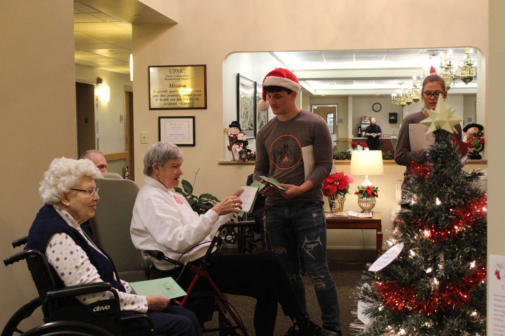 National Honor Society students spreading Holiday Cheer at Weatherwood Manor.