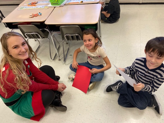 Santa's Helper Tori with first graders @West Newton Elementary