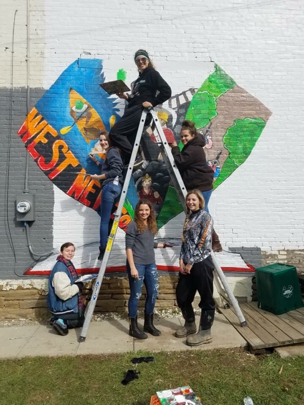 Art Students at WN Library in front of the mural they painted.