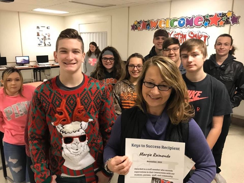 Key to Kindness Award for November  Mrs. Raimondo shown with some of her students.