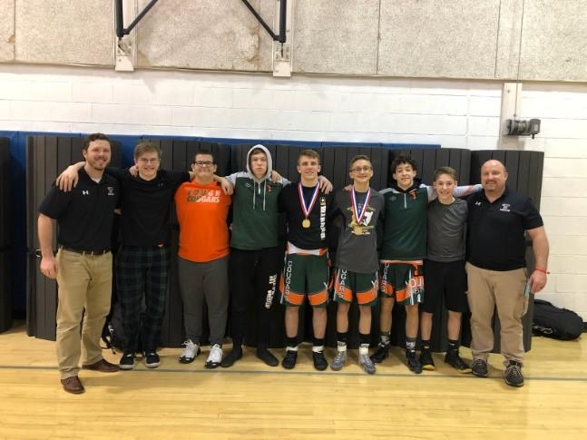 Wrestlers who attended sectionals shown with their coaches.