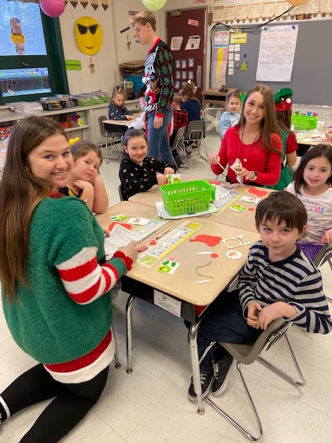 Santa's Helpers Karley and Abigail with first graders @West Newton Elementary