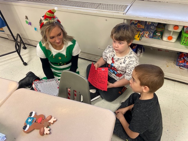 Santa's Helper Mikayla with first graders @West Newton Elementary