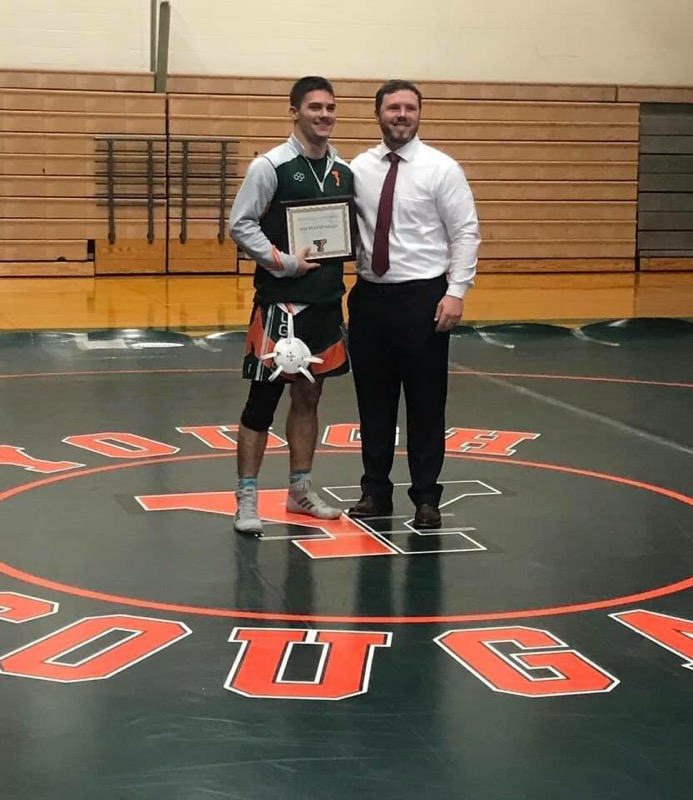 Dustin Shoaf was recognized for his achievement and team contribution in wrestling with the Bob Weaver Achievement Award on 12/19/18.
