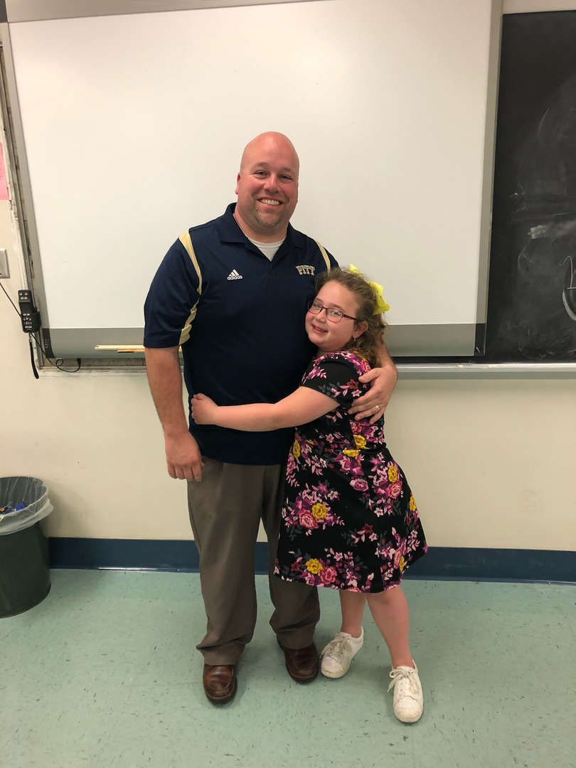 Mr. Betlan with his daughter.  Bring your child to work day!!!