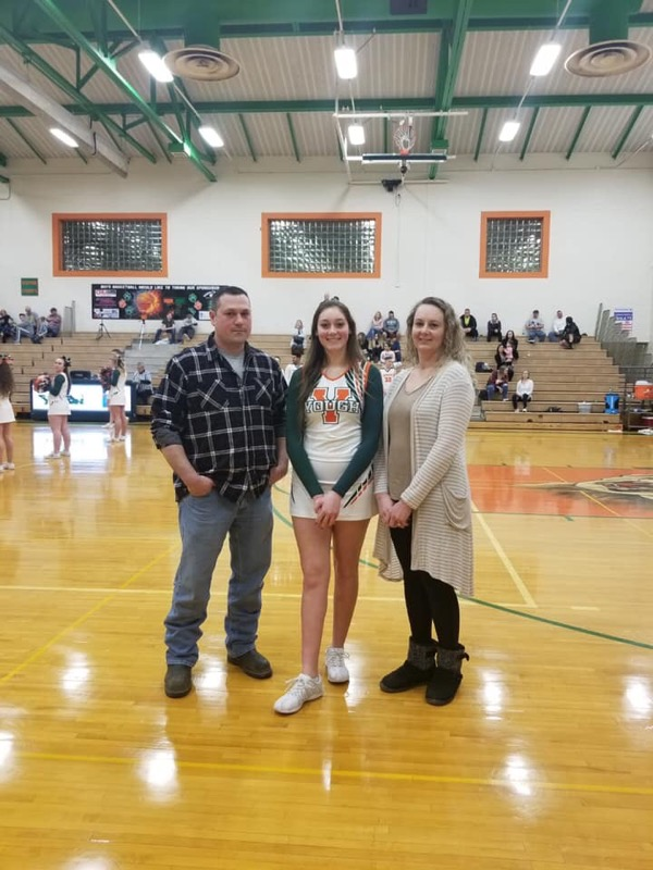 Cheerleading Cassidy with her parents