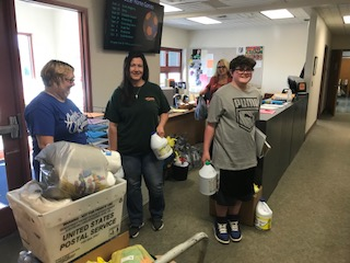 High school staff with supplies for flood victims.