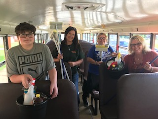 High School staff and student Wyatt stuffing a bus for flood victims.