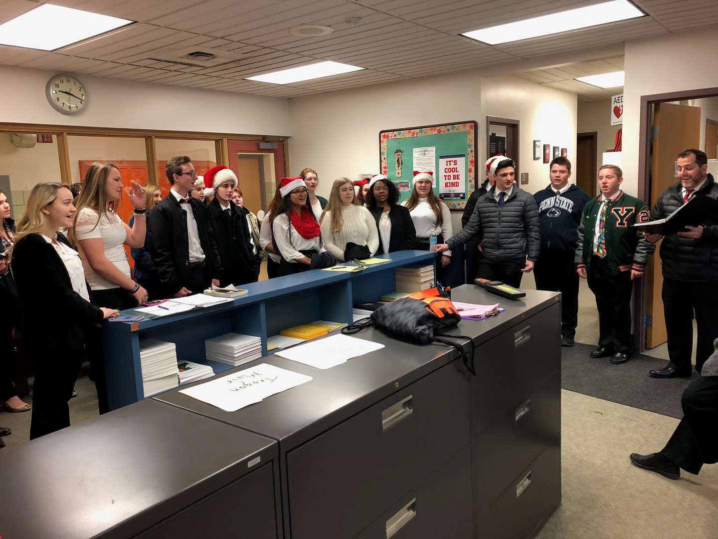 "Mr. Ritz and the Chamber Choir spreading ""Holiday Cheer"" to the office staff."