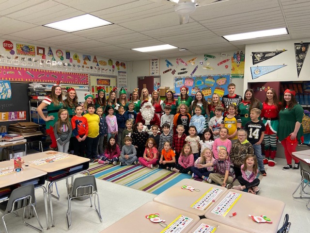 Santa and his Elves with first graders @West Newton Elementary