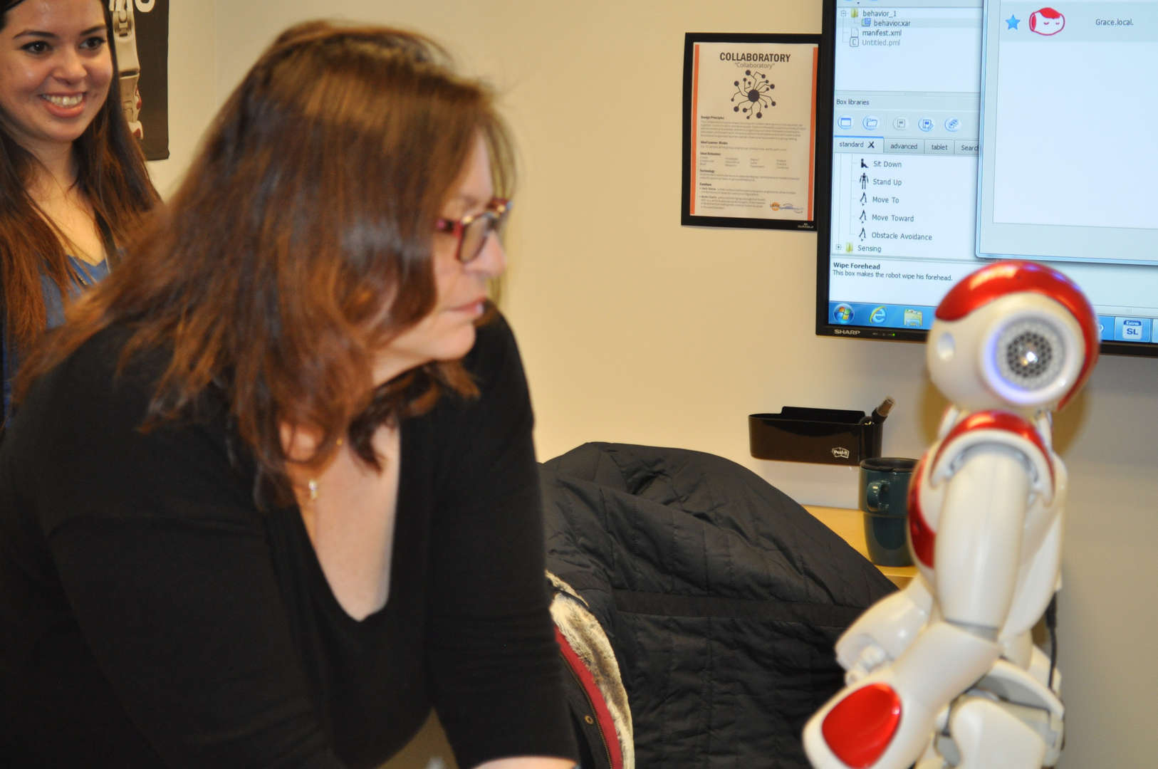 Adult learners engaged with Robotics curriculum