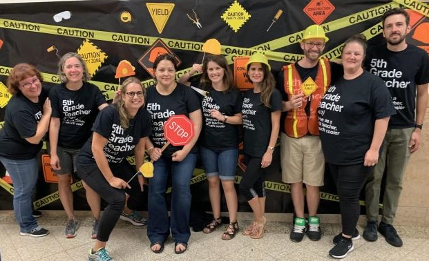 5th Grade Team - smiling teachers staged as construction workers