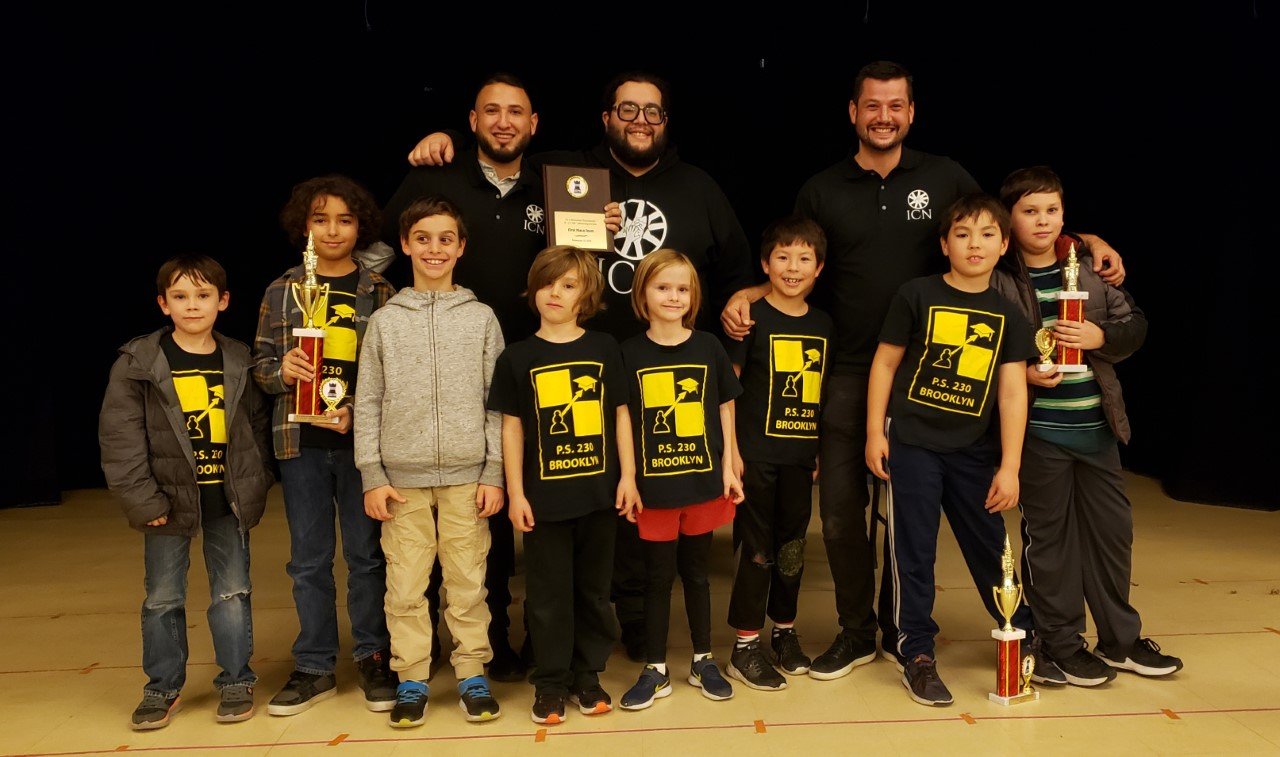 The PS 230 Chess Team accepting 1st Place at the PS 11 Team Tournament