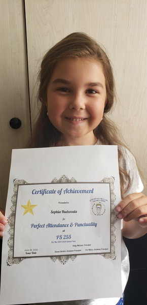 smiling girl hold printout of certificate