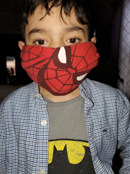 a child wearing a Spiderman mask