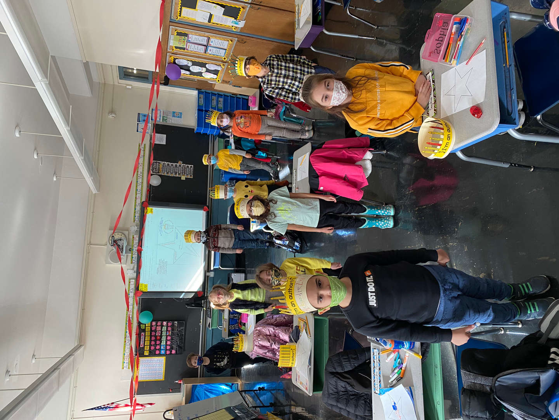 students celebrate wearing yellow