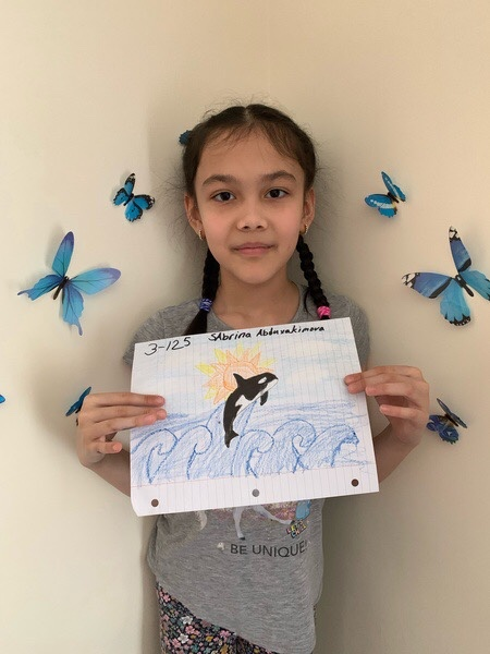 butterflies behind the girl and her whale drawing