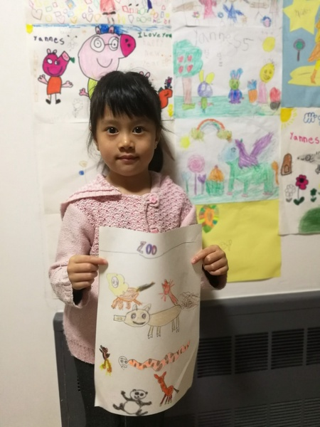 Girl happily shares her drawing