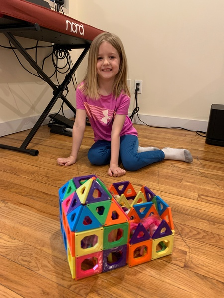 Girl shows house that she built