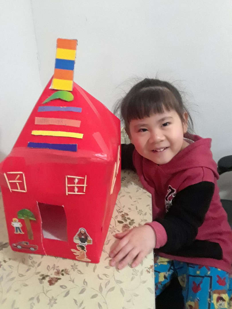 the child made a red schoolhouse