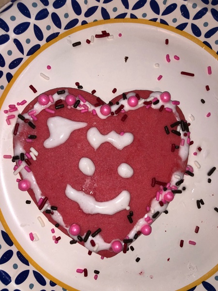 pink heart cookie with a white icing face