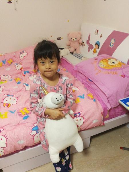 "<img src=""stuffed animal.png"" alt=""child sitting on bed holding stuffed animal"">"