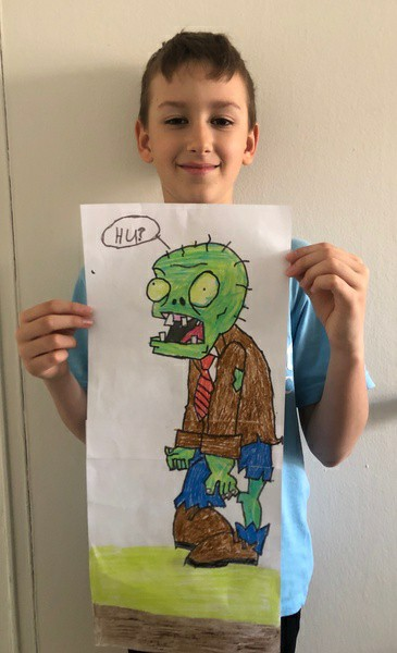 boy holds monsters vs zombies picture