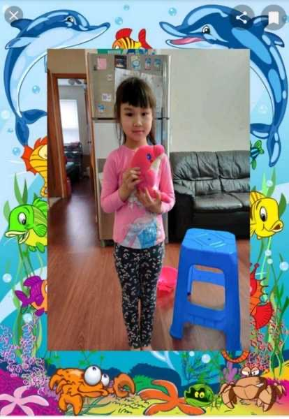 the girl holds a pink dolphin